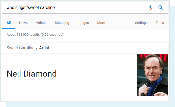 A screenshot of the SERP feature result for the query 'who sings sweet caroline' (the answer is Neil Diamond.)